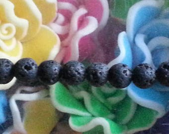 1 4mm lava stone bead, hole 1 mm