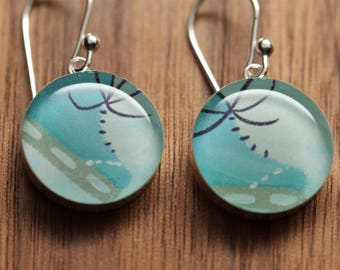 Ice skating earrings made from recycled Starbucks gift cards. sterling silver and resin.