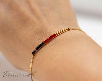 WM Germany-Fan-bracelet | Black/red/gold with 585er gold gilt