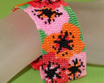 Poppies ... Peyote Bracelet . Beadwoven Cuff . Flowers . Floral . Spring . Summer . Red . Orange . Pink . Green . Bouquet . Feminine