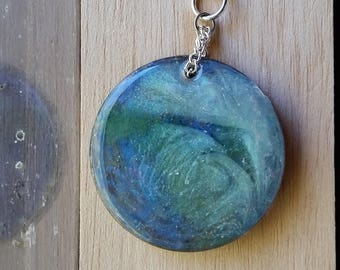 Necklace: double-sided blue, green, silver round resin pendant on silvery chain; gift for her, gift for him
