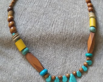 This modern beaded statement necklace with a beautiful color combination of wooden beads & Turquoise