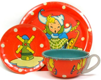 50's Tin Toy Tea Setting, Cup & plates with Dutch ice skater and ducky.