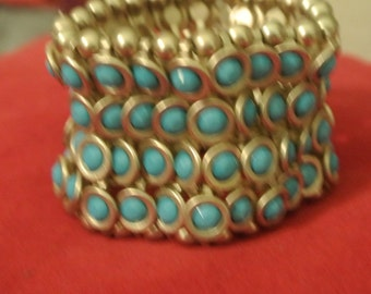 A Goldtone and Turquoise Stretch Bracelet