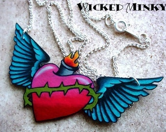 Tattoo sacred heart with wings necklace blood red heart and bright blue wings crown of thornes flame