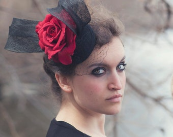 Black cocktail hat with red rose