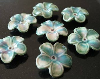 4 flower porcelain beads.  (ref:0695).