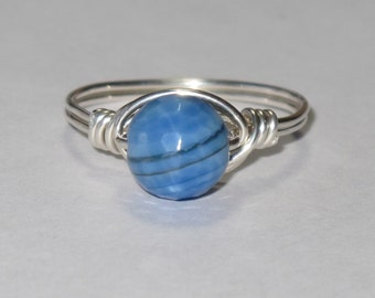 Beautiful little sterling silver and Blue Fire Agate wire wrapped ring