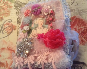 7 inch mixed media book with Marie Antoinette images, about 10 pages