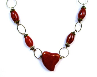 Glazed Red Clay Beads On An Oval/Round Antique Brass Chain With A Red Heart Pendant