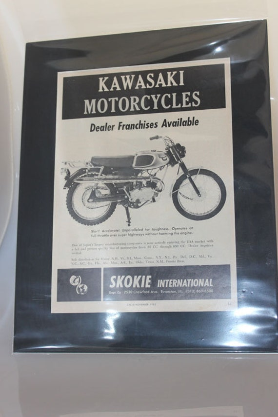 "1965 Kawasaki Motorcycles - ""Now entering the USA"" - 11"" x 14"" Original Matted Vintage Ad #e65ka16m"