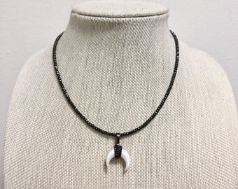 Gunmetal beaded necklace with double horn pendant