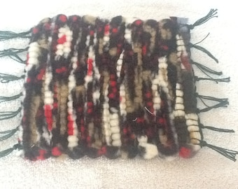 Four Handwoven Mug rugs (coasters) woven from upcycled fleese material by the seller.