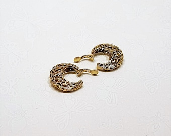 Gold Filigree Fashion Clip On Earrings presented by Donellensvintage