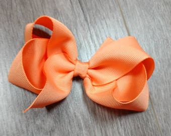 4 inch Peach hair bow. Solid Peach color hair bow. 4 in hair bow. Toddler peach hair bow. Girls 4 in hair bow. Toddler bow. Peach hair bow.