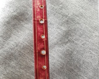 """An elegant burgandy leather bracelet. This will fit a 7"""" wrist."""