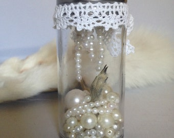 white lace squirrel paw and pearls display