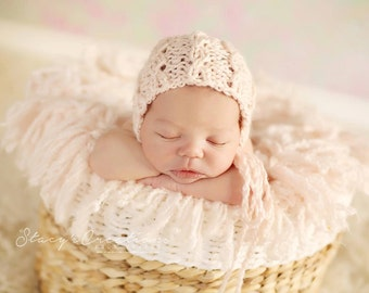 Newborn knit baby cables bonnet in alpaca color is peony