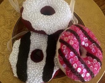 A set of three hand beaded felt donut ornaments