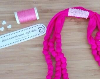 Three-wire cotton Fuchsia necklace knots