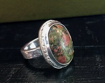 Silver Ring with Oval Cabochon Rubalite Stone
