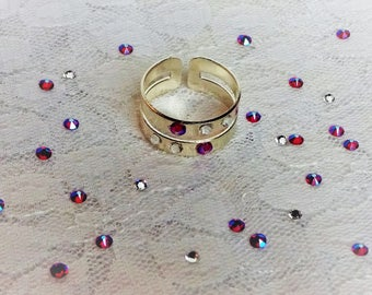 Large ring ring in silver embellished with Swarovski crystals.