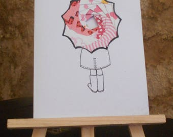 Little girl with umbrella in iris folding card