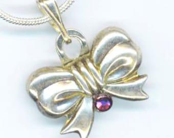 Sterling Silver Vintage Bow Pendant . Sparkling Swarovski Purple Amethyst. Elegant Infinity Sign - Love& Friendship by enchantedbeas on Etsy