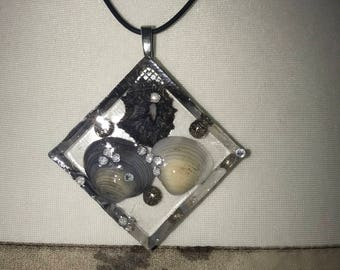 Handmade glass effect resin pendant with beautiful Scottish seashells and floating sparkles