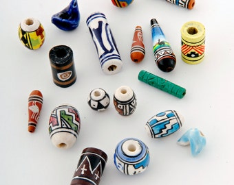 Hand painted clay ceramic beads x 50 mixed shapes, colours, sizes. Hand made and painted in Peru by artisans in Cuzco and fairtrade (bp599b)