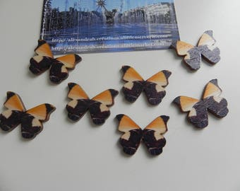 8 wooden 28 x 21 mm black and yellow butterflies