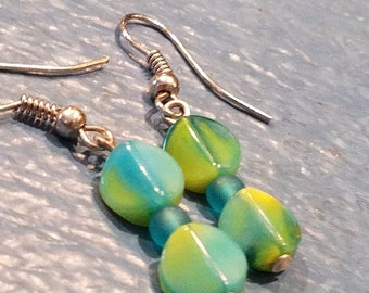 Dangle earrings featuring distinctive glass beads gradating in color from turquoise through green to yellow  silver hypoallergenic ear wires