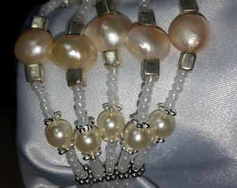 5 strands white freshwater pearls bracelet.