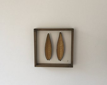 Modern African wall art / picture containing natural botanical seed pods