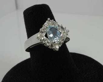 1 ct natural aquamarine (0.95ct) with 16x2mm natural white sapphires set in silver engagement ring.