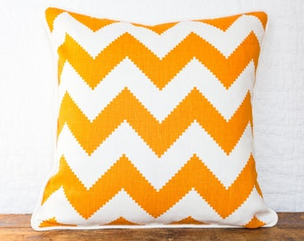 Orange and ivory chevron pillow cover