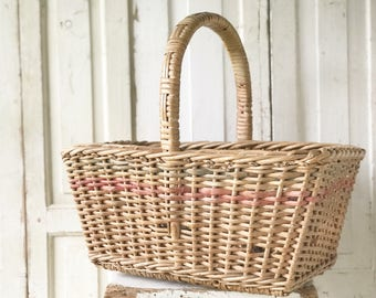 A lovely vintage basket with pink and green stripe