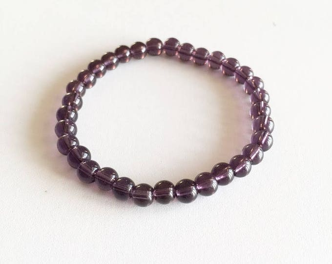 Transparent purple glass beads bracelet