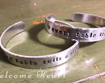 Every Table Tells a Story Cuff