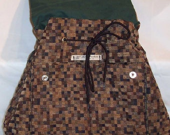 Clara Backpack in Black, Brown, and Taupe Upholstery Fabric with green duck fabric lining