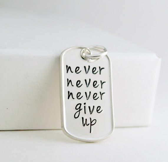 Never never never give up pendant dog tag hand stamped aloadofball Images