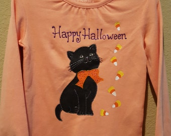 Long sleeved top featuring an adorable Halloween Cat