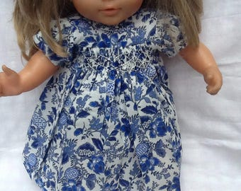 dress has smocked blue flowers, doll 36 cm