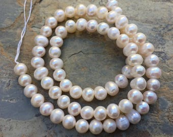 White Pearl Beads, Near Round Pearl Beads, 6 x 7mm approx, 16 inch strand.