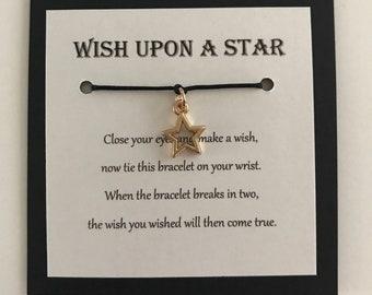 Faire un voeu sur un or bracelet étoile rose