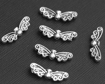 10 pcs of antiqued silver angel wings spacer beads 22x7mm