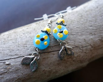 Glass Lampwork Bead Earrings | Blue Yellow and Black Dangle with Silver Leaf Accents