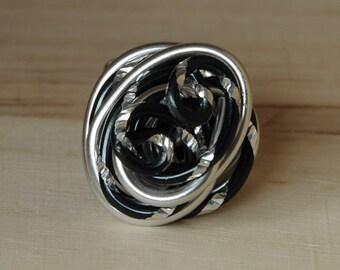 Spiral statement ring