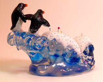 "Pincushion. Frolicking Penguins On An Iceberg  5.5"" W by 4"" H,  9 oz net, #1968  Pin Cushion"