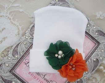 University of Miami Fans, white hospital hat, adorned with UM colored flowers, baby hat, Lil Miss Sweet Pea Boutique